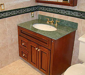 bathroom with custom tile and marble top sink