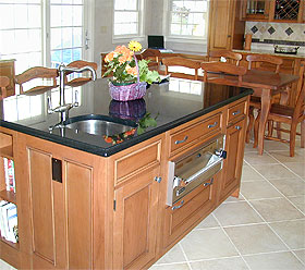 built-in kitchen island with black marble top